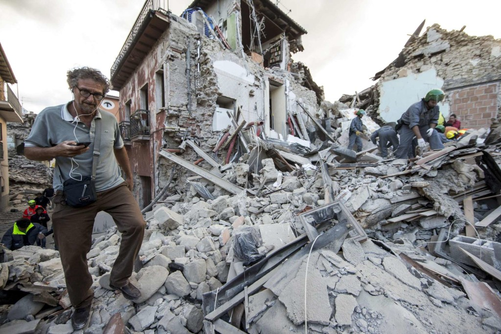 Rescuers on the rubble in Amatrice, central Italy, where a 6.1 earthquake struck just after 3:30 a.m., Wednesday, Aug. 24, 2016. The quake was felt across a broad section of central Italy, including the capital Rome where people in homes in the historic center felt a long swaying followed by aftershocks. ANSA/ MASSIMO PERCOSSI